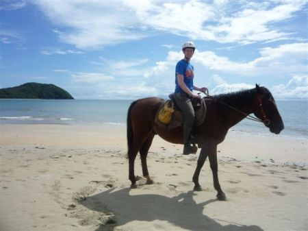 Taking the horse for a little wander along the beach